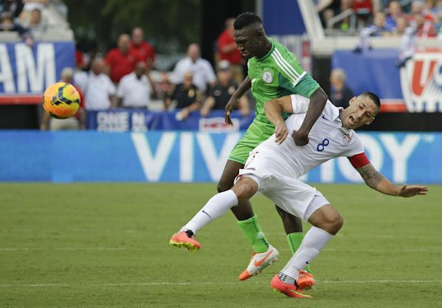 Nigeria's Reuben Gabriel, left, and United States's Clint Dempsey (8) get tangled up while trying to gain possession of the ball during the second half of an international friendly soccer match in Jacksonville, Fla., Saturday, June 7, 2014. The United States won 2-1. (AP Photo/John Raoux)
