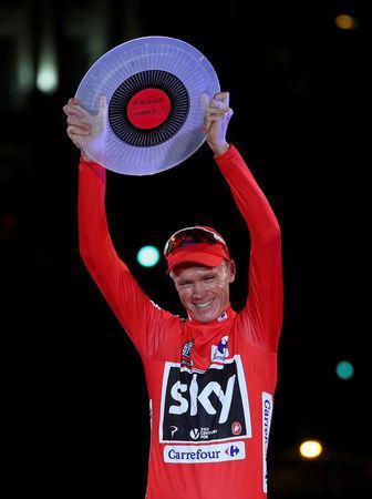 FILE PHOTO: Team Sky rider Chris Froome of Britain celebrates on the podium after winning the Vuelta Tour of Spain after the last stage of the cycling race between Arroyomolinos and Madrid, September 10, 2017. REUTERS/Susana Vera/File Photo