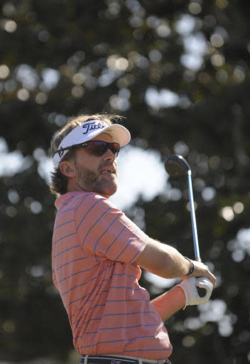 Brett Quigley watches his tee shot on the first hole during the third round of the Children's Miracle Network Classic PGA golf tournament in Lake Buena Vista, Fla., Saturday, Nov. 13, 2010. (AP Photo/Phelan M. Ebenhack)