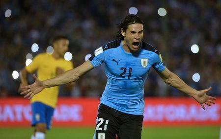 Football Soccer - Uruguay v Brazil - World Cup 2018 Qualifiers - Centenario stadium, Montevideo, Uruguay - 23/3/17 - Uruguay's Edinson Cavani celebrates after scoring a penalty. REUTERS/Carlos Pazos
