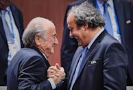 FIFA President Sepp Blatter (L) shakes hands with UEFA President Michel Platini after being re-elected, in Zurich on May 29, 2015 (AFP Photo/Michael Buholzer)