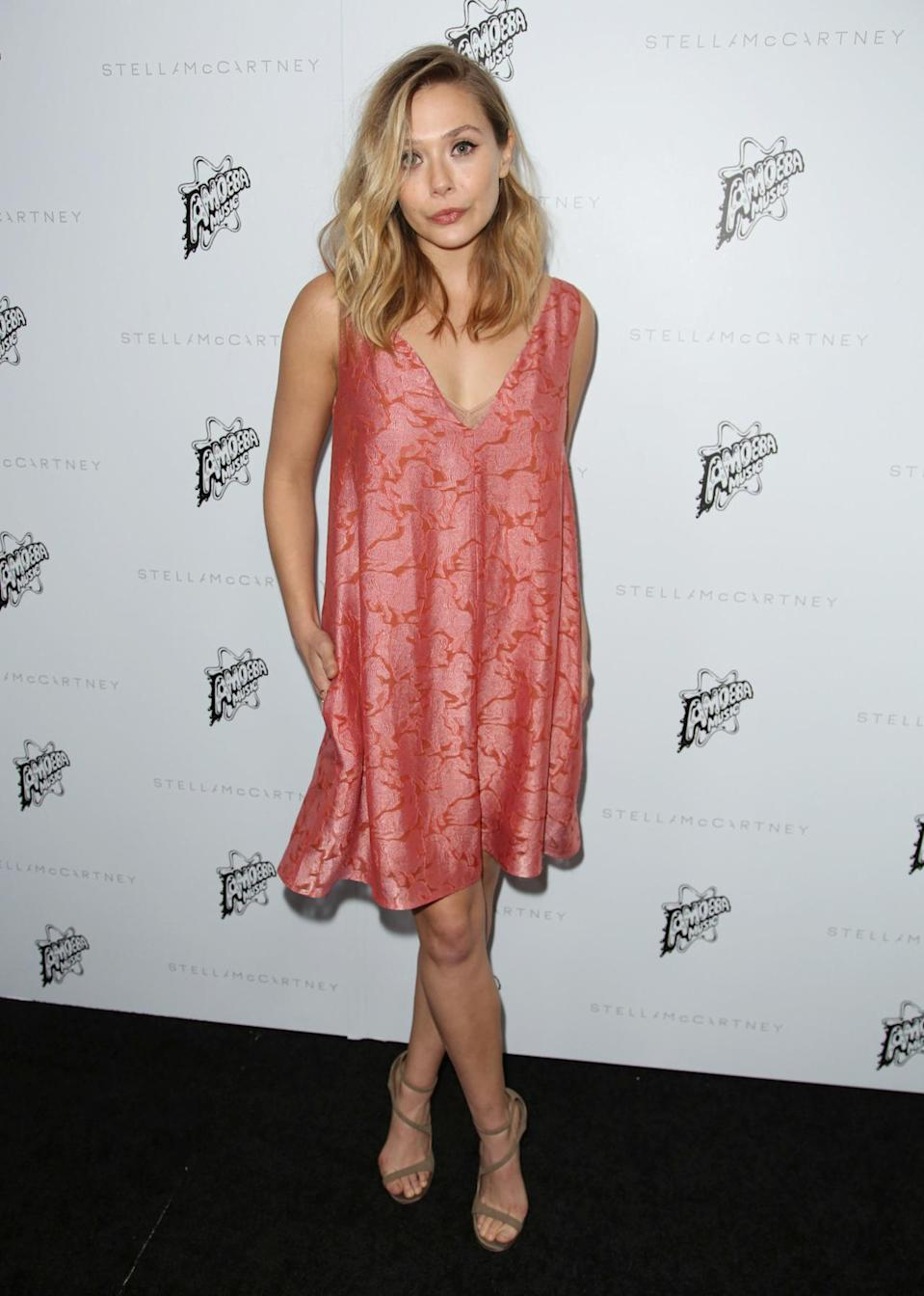 <p>Mary-Kate and Ashley's sister looked summery in this pink sleeveless dress. <i>[Photo: Rex]</i></p>