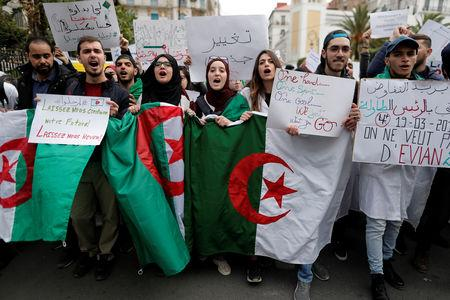 FILE PHOTO: Students shout slogans during a protest calling on President Abdelaziz Bouteflika to quit, in Algiers, Algeria March 19, 2019. REUTERS/Zohra Bensemra/File Photo