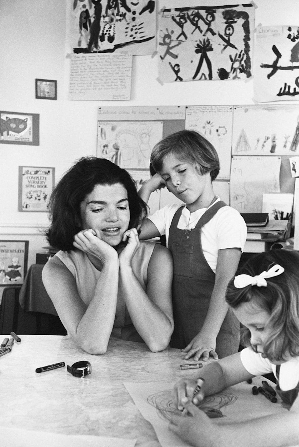 """<p>Jackie was extremely invested in keeping her children away from the press and, given that it had become impossible for her eldest to travel in the city without a trail of photographers, Jackie decided to open a <a href=""""http://www.history.com/news/10-things-you-may-not-know-about-jacqueline-kennedy-onassis"""" rel=""""nofollow noopener"""" target=""""_blank"""" data-ylk=""""slk:school"""" class=""""link rapid-noclick-resp"""">school</a> on the third floor of the White House. Jackie invited other kids to join, and eventually her third floor was transformed into a legitimate kindergarten classroom with qualified, professional teachers, ten students, and even a couple of animals. </p>"""