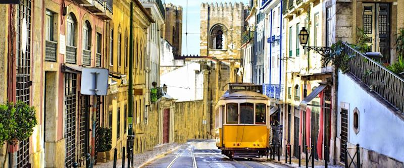 Lisbon street with the Cathedral in the background