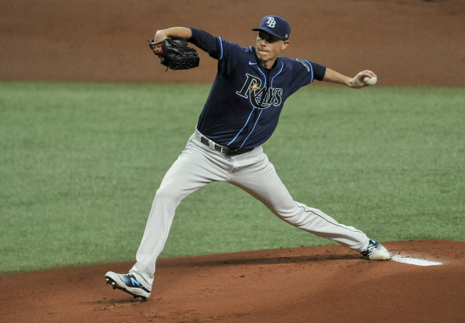 Tampa Bay Rays starter Ryan Yarbrough pitches against the Texas Rangers during the first inning of a baseball game Tuesday, April 13, 2021, in St. Petersburg, Fla. (AP Photo/Steve Nesius)
