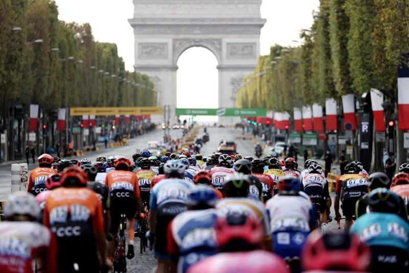 The pack rides on the Champs Elysees avenue with the Arc de Triomphe in the background during the 21st and last stage of the 107th edition of the Tour de France cycling race 122 km between ManteslaJolie and Champs Elysees Paris on September 20 2020 Photo by KENZO TRIBOUILLARD AFP Photo by KENZO TRIBOUILLARDAFP via Getty Images