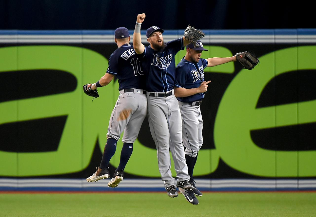 Aug 15, 2017; Toronto, Ontario, CAN; Tampa Bay Rays right fielder Steven Souza Jr. (20, center) jumps in celebration with left fielder Corey Dickerson (10) and center fielder Peter Bourjos (18) after defeating the Toronto Blue Jays at Rogers Centre. Mandatory Credit: Dan Hamilton-USA TODAY Sports      TPX IMAGES OF THE DAY