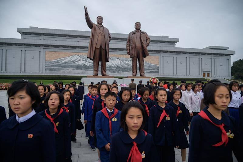 Students visit the statues of late North Korean leaders Kim Il Sung and Kim Jong Il in Pyongyang in October 2019.
