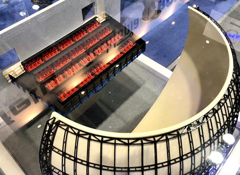 Simtec displayed a model of its new HexaFlite flying theater ride system. The attraction offers new ways to move passengers' seats and immerse them in the experience.