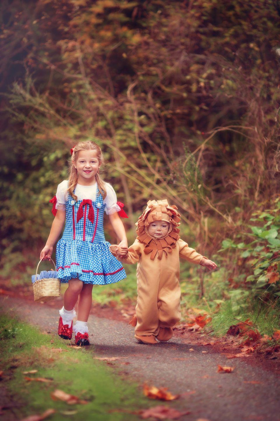 """<p>Every little girl loves donning pigtails and a checkered dress and going as Dorothy on Halloween. Dress the other members of your family as the cowardly lion, the tin man, or the scarecrow for a costume that's sure to be a hit. </p><p><a class=""""link rapid-noclick-resp"""" href=""""https://www.amazon.com/Wizard-Deluxe-Dorothy-Costume-Large/dp/B00BJH4M5C/?tag=syn-yahoo-20&ascsubtag=%5Bartid%7C10055.g.33300912%5Bsrc%7Cyahoo-us"""" rel=""""nofollow noopener"""" target=""""_blank"""" data-ylk=""""slk:SHOP DOROTHY COSTUMES"""">SHOP DOROTHY COSTUMES</a></p><p><a class=""""link rapid-noclick-resp"""" href=""""https://www.amazon.com/Fun-World-Costumes-Toddler-Costume/dp/B002EDS1HA/?tag=syn-yahoo-20&ascsubtag=%5Bartid%7C10055.g.33300912%5Bsrc%7Cyahoo-us"""" rel=""""nofollow noopener"""" target=""""_blank"""" data-ylk=""""slk:SHOP LION COSTUMES"""">SHOP LION COSTUMES</a></p>"""