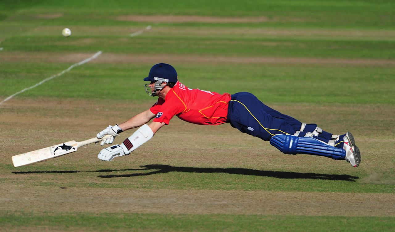 TAUNTON, ENGLAND - SEPTEMBER 11:  James Foster of Essex dives successfully to make his grond during the Clydesdale Bank 40 Semi Final between Somerset and Essex on September 11, 2010 in Taunton, England.  (Photo by Mike Hewitt/Getty Images)