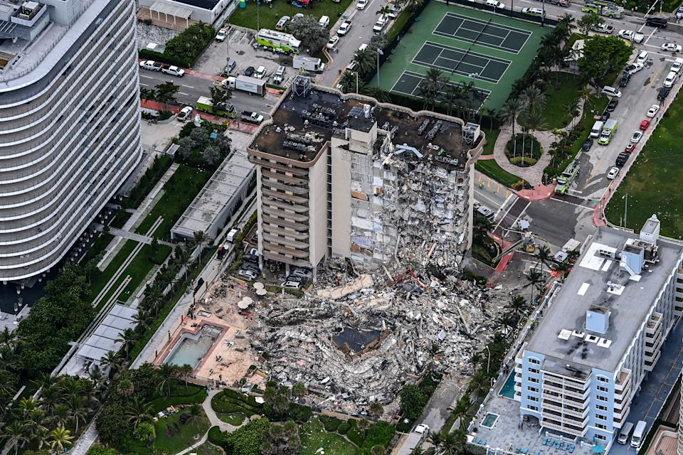 This aerial view, shows search and rescue personnel working on site after the partial collapse of the Champlain Towers South in Surfside, north of Miami Beach, on June 24, 2021. - The multi-story apartment block in Florida partially collapsed early June 24, sparking a major emergency response. Surfside Mayor Charles Burkett told NBCs Today show: My police chief has told me that we transported two people to the hospital this morning at least and one has died. We treated ten people on the site. (Photo by CHANDAN KHANNA / AFP) (Photo by CHANDAN KHANNA/AFP via Getty Images)