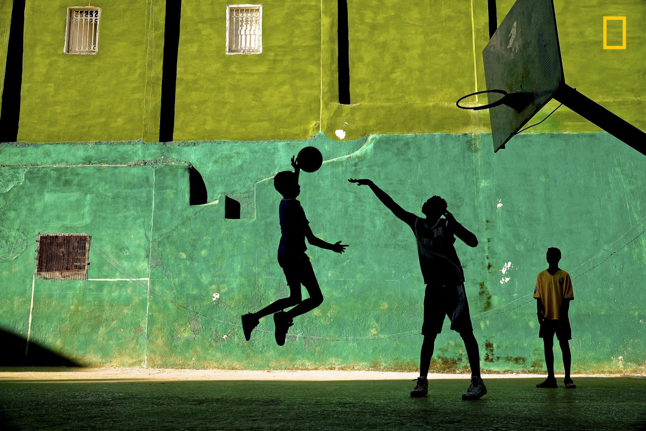 <p>Young boys play basketball after school in a Havana neighborhood, Cuba. (© Jeremy Lasky/National Geographic Travel Photographer of the Year Contest) </p>