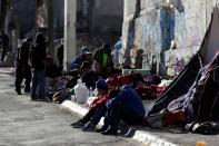 Migrants rest in an improvised shelter set up outside the Posada Belen migrant shelter, which is closed due to an outbreak of the coronavirus disease COVID-19, in Saltillo
