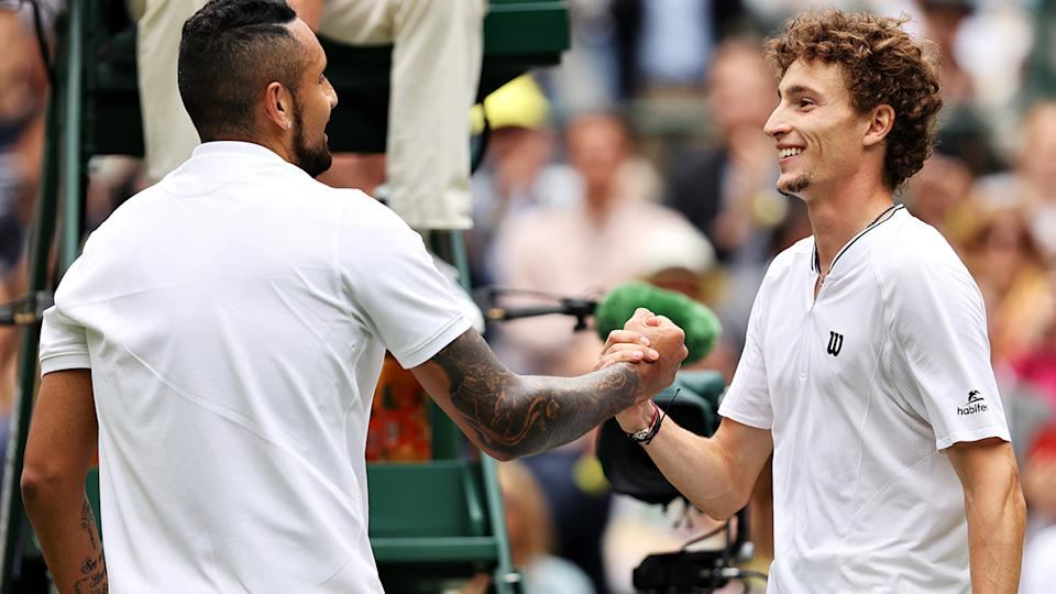 Nick Kyrgios and Ugo Humbert shake hands after their five-set marathon in Wimbledon's first round. (Photo by Clive Brunskill/Getty Images)