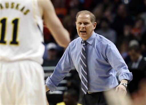 Michigan head coach John Beilein reacts during the first half of an NCAA college basketball game at the Big Ten tournament against Penn State Thursday, March 14, 2013, in Chicago. (AP Photo/Charles Rex Arbogast)