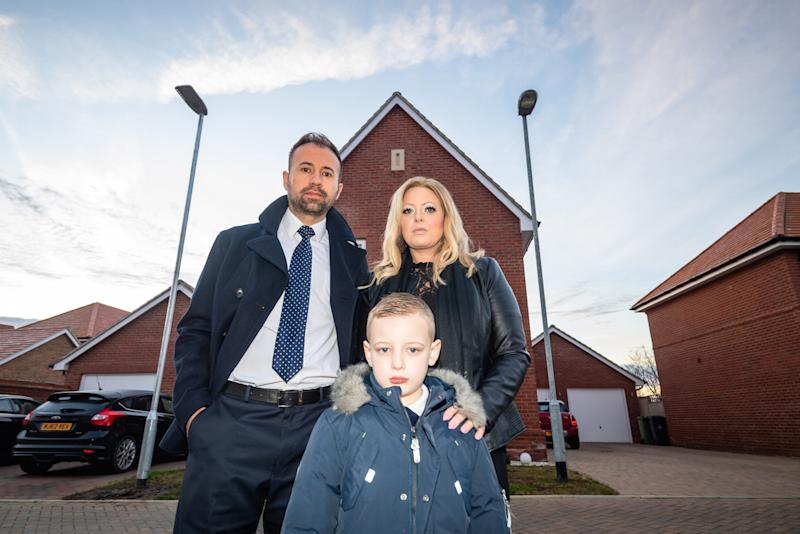 Steve Price, his wife Louise and their son Charlie outside their home in Maldon, Essex. (SWNS)