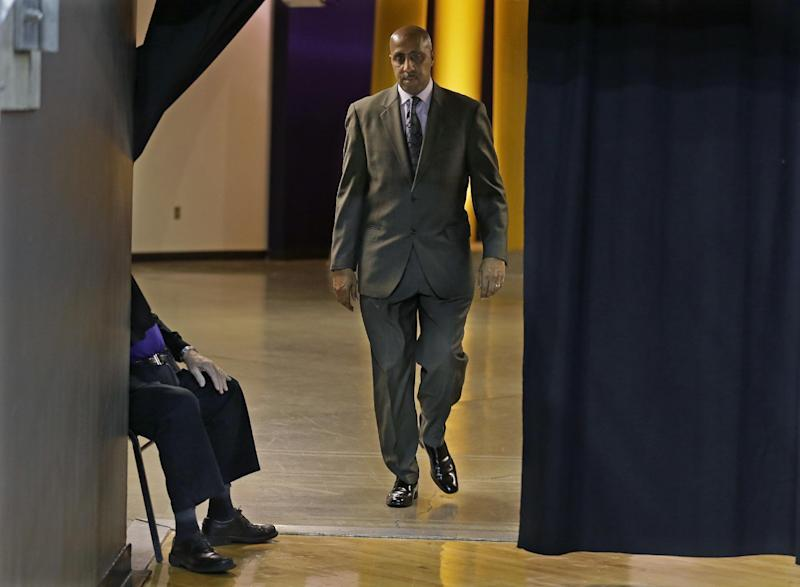 FILE - In this Jan. 18, 2017 file photo, Washington coach Lorenzo Romar walks past a curtain as he heads to the court for the team's NCAA college basketball game against Colorado in Seattle. Washington announced Wednesday, March 15, 2017, that Romar had been fired after 15 seasons at the school. (AP Photo/Ted S. Warren, file)