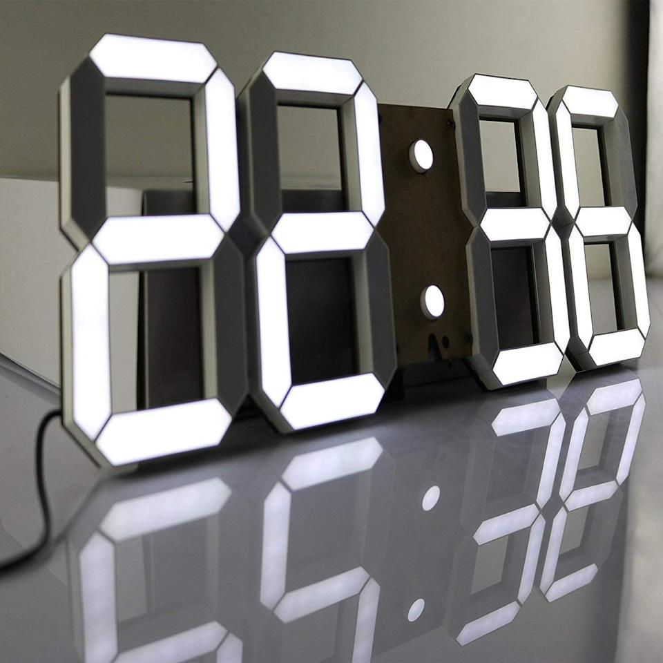 <p>This <span>Pinty Multi-Functional Remote Control Large LED Digital Wall Clock</span> ($85) is pretty cool. </p>