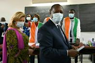 Ivorian President Alassane Ouattara (R) angered the opposition with his bid for a third term
