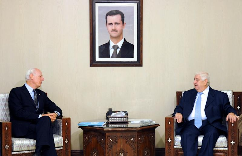A picture provided by official news agency SANA shows Syrian Deputy Prime Minister and Foreign Minister Walid Muallem meeting with UN special envoy Staffan de Mistura in Damascus on September 17, 2015 (AFP Photo/)