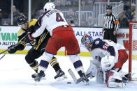 Columbus Blue Jackets defenseman Scott Harrington (4) keeps Boston Bruins right wing Chris Wagner (14) away from the puck as Blue Jackets goaltender Elvis Merzlikins (90) protects the net in the second period of an NHL hockey game, Thursday, Jan. 2, 2020, in Boston. (AP Photo/Elise Amendola)
