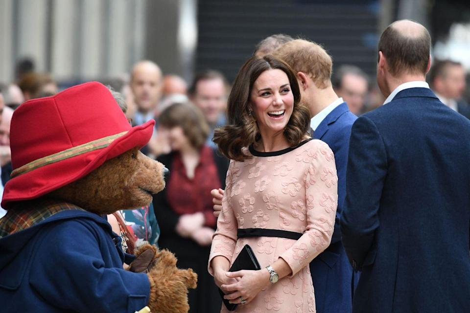 <p>Middleton shared a laugh with Paddington Bear at an event held at a London train station in 2017. The Duchess revealed a growing baby bump, as she was expecting her third child. </p>