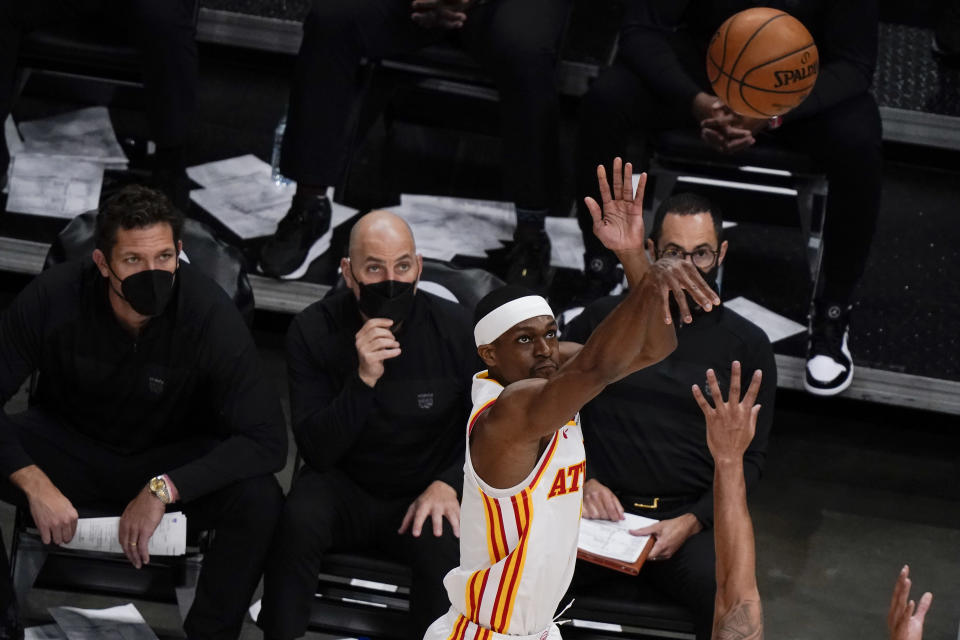 Atlanta Hawks' Rajon Rondo shoots and scores against the Sacramento Kings during the second half of an NBA basketball game on Saturday, March 13, 2021, in Atlanta. (AP Photo/Brynn Anderson)
