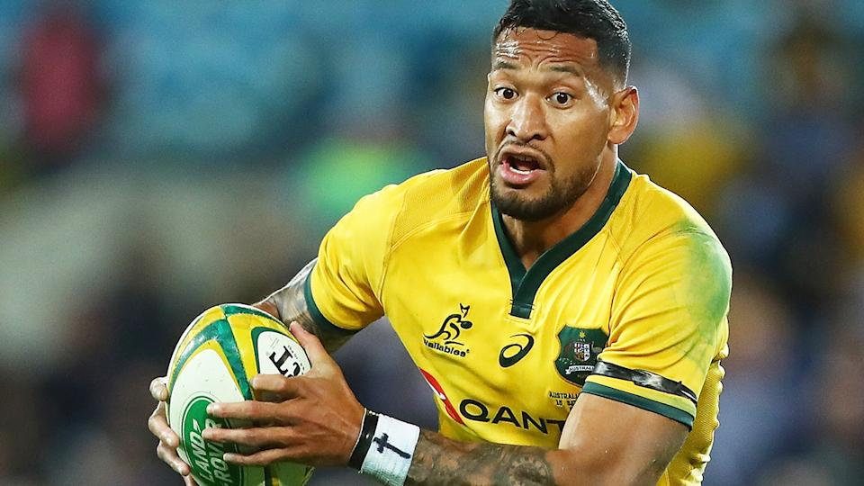 Israel Folau is pictured playing for the Wallabies.