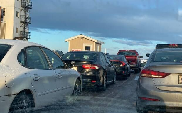 People line up in their vehicles for testing in Slemon Park, just outside of Summerside, after cases with no known link to travel were announced last Thursday. Five new cases were confirmed Sunday, but there were no additional cases as of Monday afternoon.  (Submitted by Bill Schurman - image credit)