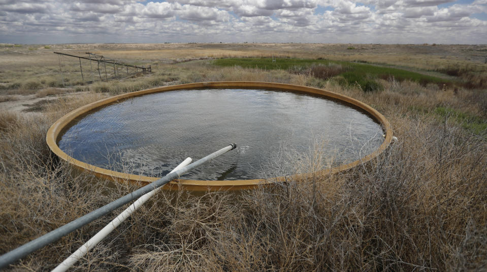 A natural spring fed by the Ogallala Aquifer fills a stock tank that provides water for wildlife at the Muleshoe National Wildlife Refuge outside Muleshoe, Texas, on Tuesday, May 18, 2021. The aquifer has become increasingly dry because of irrigation and drought. (AP Photo/Mark Rogers)