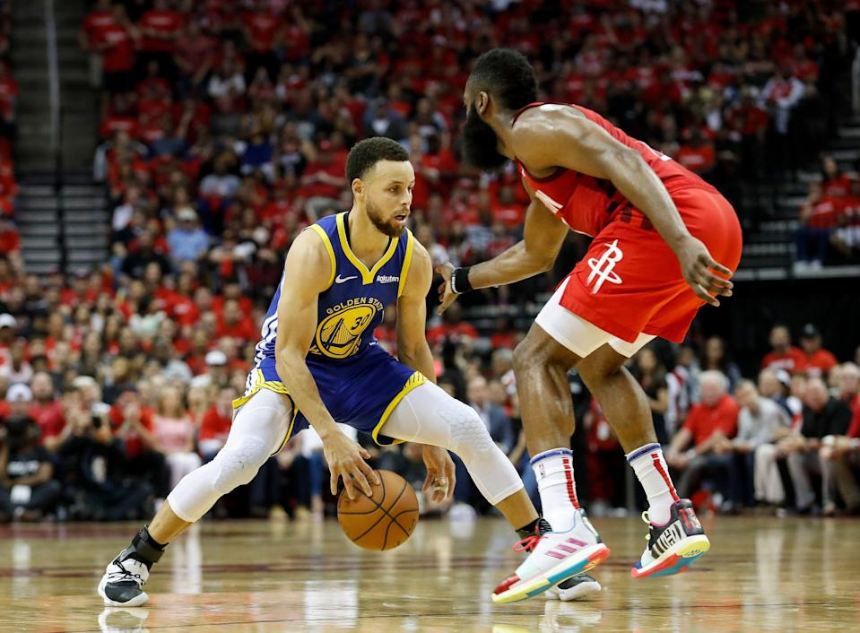 HOUSTON, TX - MAY 04:  Stephen Curry #30 of the Golden State Warriors dribbles the ball defended by James Harden #13 of the Houston Rockets in the fourth quarter during Game Three of the Second Round of the 2019 NBA Western Conference Playoffs at Toyota Center on May 4, 2019 in Houston, Texas.  NOTE TO USER: User expressly acknowledges and agrees that, by downloading and or using this photograph, User is consenting to the terms and conditions of the Getty Images License Agreement.  (Photo by Tim Warner/Getty Images)