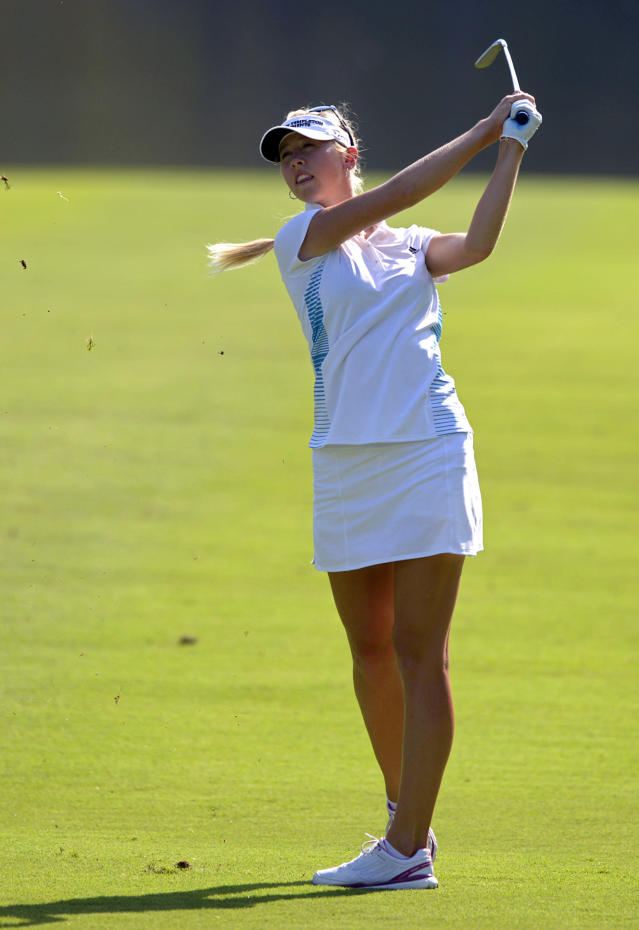 Jessica Korda hits her second shot from the 18th fairway in the final round of the Airbus LPGA Classic golf tournament at Magnolia Grove on Sunday, May 25, 2014, in Mobile, Ala. (AP Photo/G.M. Andrews)