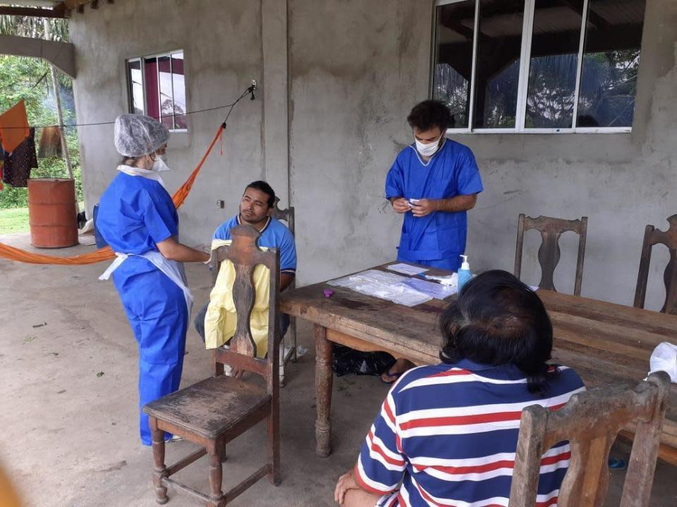 In this photo taken Wednesday, May 27, 2020, medial workers take care of residents of the remote village of Camopi, French Guiana. France's most worrisome virus hotspot is in fact on the border with Brazil - in French Guiana, a former colony where health care is scarce and poverty is rampant. The pandemic is exposing deep economic and racial inequality in French Guiana that residents say the mainland has long chosen to ignore. (AP Photo)