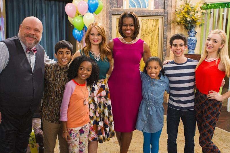 """Former first lady Michelle Obama also met Boyce on the set of """"Jessie."""" (Photo: Adam Rose via Getty Images)"""