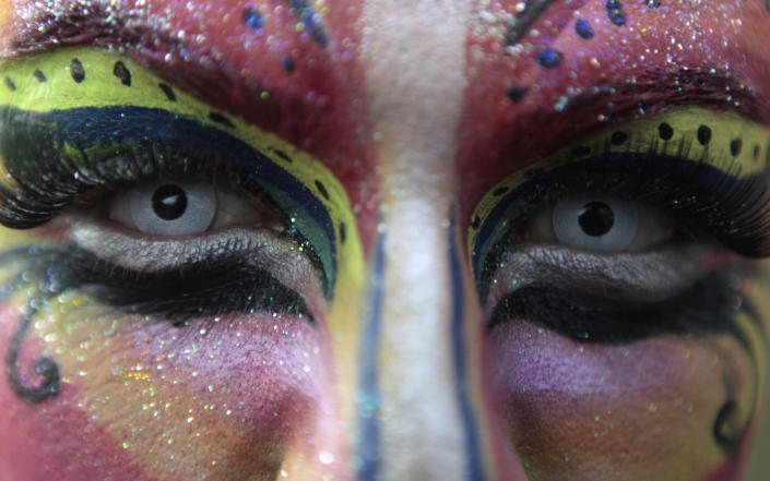 A person with a painted face attends a parade celebrating Sexual Diversity Day in Managua, Nicaragua, Tuesday June 28, 2011. (AP Photo/Esteban Felix)