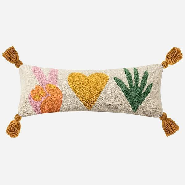"""<p>Add some positive vibes to your sofa with the <a href=""""https://www.popsugar.com/buy/Jungalow-Peace-Love-Plants-Hook-Pillow-Justina-Blakeney-584978?p_name=Jungalow%20Peace%2C%20Love%20%2B%20Plants%20Hook%20Pillow%20by%20Justina%20Blakeney%C2%AE&retailer=jungalow.com&pid=584978&price=50&evar1=casa%3Aus&evar9=45784601&evar98=https%3A%2F%2Fwww.popsugar.com%2Fhome%2Fphoto-gallery%2F45784601%2Fimage%2F47575743%2FJungalow-Peace-Love-Plants-Hook-Pillow-by-Justina-Blakeney&list1=shopping%2Cproducts%20under%20%2450%2Cdecor%20inspiration%2Caffordable%20shopping%2Chome%20shopping&prop13=api&pdata=1"""" class=""""link rapid-noclick-resp"""" rel=""""nofollow noopener"""" target=""""_blank"""" data-ylk=""""slk:Jungalow Peace, Love + Plants Hook Pillow by Justina Blakeney®"""">Jungalow Peace, Love + Plants Hook Pillow by Justina Blakeney®</a> ($50).</p>"""
