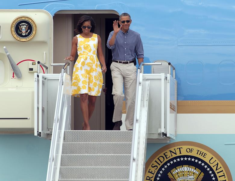 President Barack Obama and first lady Michelle Obama arrive at the Cape Cod Coast Guard Station in Bourne, Mass., Saturday, Aug. 10, 2013, en route to a family vacation on Martha's Vineyard. (AP Photo/Stew Milne)