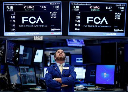 A specialist trader works at the post where Fiat Chrysler Automobiles is traded on the floor of the New York Stock Exchange (NYSE) in New York, U.S., March 8, 2017. REUTERS/Brendan McDermid