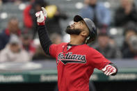 Cleveland Indians' Bobby Bradley celebrates after hitting a solo home run in the fourth inning in the first baseball game of a doubleheader against the Chicago White Sox, Thursday, Sept. 23, 2021, in Cleveland. (AP Photo/Tony Dejak)