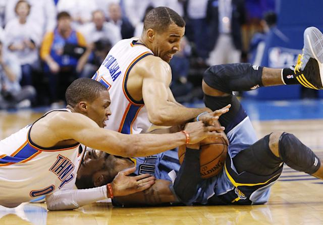 Oklahoma City Thunder guard Russell Westbrook (0) and guard Thabo Sefolosha (25) attempt to take the ball away from Memphis Grizzlies guard Mike Conley (11) in overtime of Game 2 of an opening-round NBA basketball playoff series in Oklahoma City, Monday, April 21, 2014. Memphis won 111-105 in overtime. (AP Photo/Sue Ogrocki)