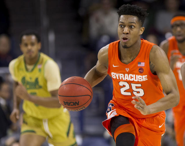 Syracuse's Tyus Battle (25) drives down court during the first half of an NCAA college basketball game against Notre Dame, Saturday, Jan. 5, 2019, in South Bend, Ind. (AP Photo/Robert Franklin)