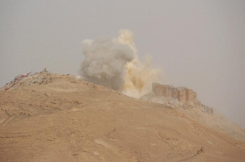 Smoke billows from the Palmyra citadel during a military operation by Syrian troops to retake the ancient city from the jihadist Islamic State (IS) group (AFP Photo/)