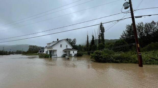 At least 12 families have been displaced and the village's seniors' home was evacuated as a preventative measure. (Courtesy of André Richard - image credit)