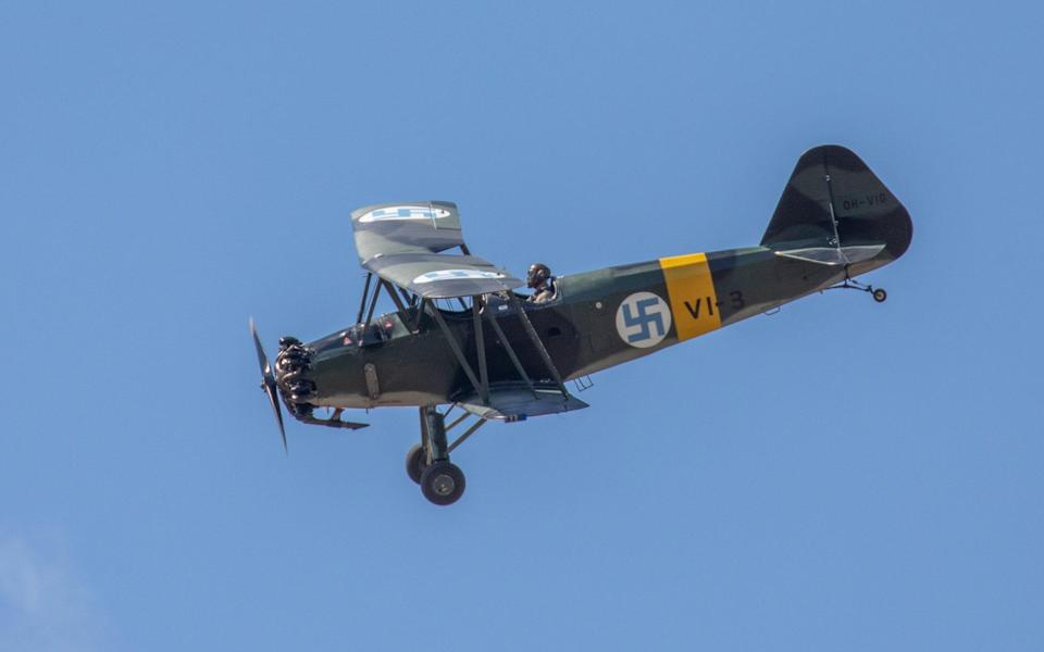 A vintage Finnish Air Force plane bearing a swastika flying at an air show in 2018 - Alamy Stock Photo