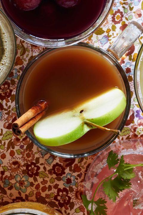 "<p>Warm your guests up by offering them a mug of warm mulled cider as they arrive.</p><p><strong><a href=""https://www.countryliving.com/food-drinks/recipes/a36542/slow-cooker-apple-cider/"" rel=""nofollow noopener"" target=""_blank"" data-ylk=""slk:Get the recipe."" class=""link rapid-noclick-resp"">Get the recipe.</a>.</strong></p>"