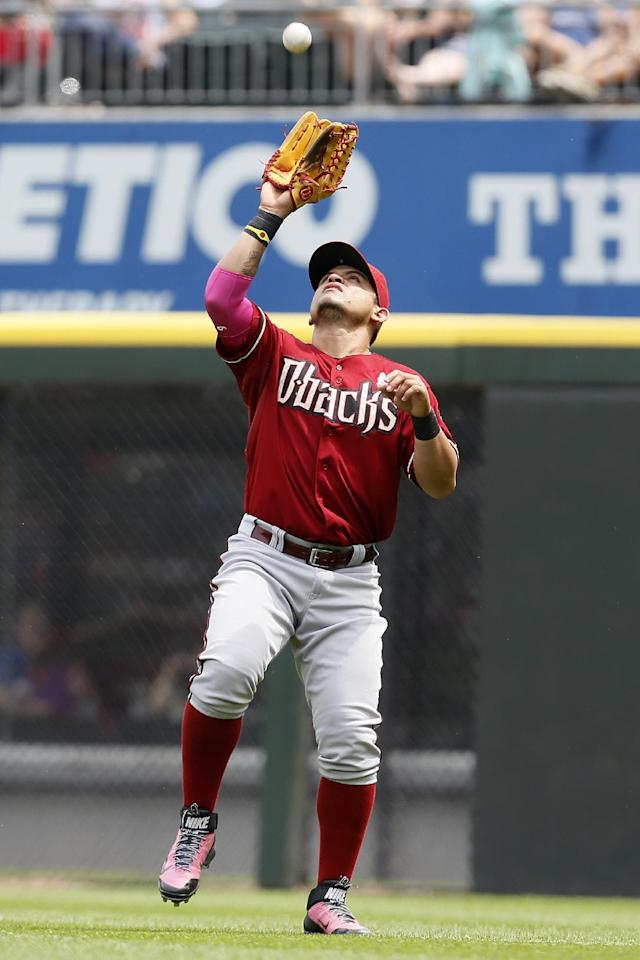 Arizona Diamondbacks right fielder Gerardo Parra catches a fly ball hit by the Chicago White Sox's Gordon Beckham during the fourth inning of a baseball game on Sunday, May 11, 2014, in Chicago. (AP Photo/Andrew A. Nelles)