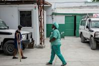 A medical worker is seen at a hospital run by Doctors Without Borders in Haiti -- the medical aid charity has been vital in efforts to ensure the poor get quality health care