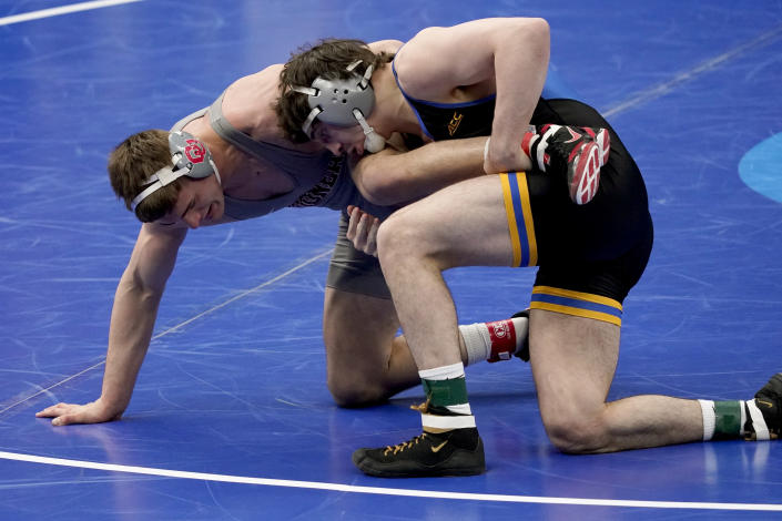 Pittsburgh's Nino Bonaccorsi takes on Oklahoma's Jake Woodley, left, during their 197-pound match in the semifinal round of the NCAA wrestling championships Friday, March 19, 2021, in St. Louis. (AP Photo/Jeff Roberson)
